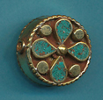 4 petal flower in circle turquoise