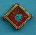 Brass square, coral with turquoise circle center.JPG