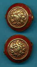 Carved brass round with coral.JPG