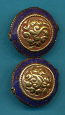 Carved brass round with lapis.JPG