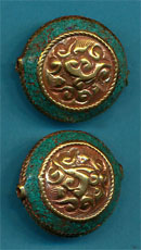 Carved brass round with turquoise.JPG